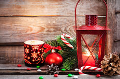 Christmas time red latern with candle light and holiday decorati Royalty Free Stock Photo