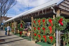 Christmas Time at the Salem Farmers Market 2017 -3. Salem, VA – November 27th: Vendors making Christmas wreaths at the Salem Farmers Market on November 28th Royalty Free Stock Photos