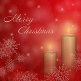 Christmas time - Second Advent candle red. The second Advent with candle and Christmas landscape. Text : Merry Christmas Stock Image