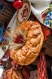 Christmas time with traditional bread, sausages and decoration from Romania. Traditional bread, sausages and decoration from Maramures area, Romania, arranged at Stock Photo