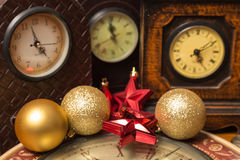 Christmas time. View of a group of watches with Christmas tree ornaments Stock Photo