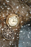 Christmas time. Vintage pocket watch and falling snow Royalty Free Stock Photos