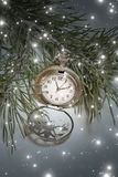 Christmas time. Vintage pocket watch and falling snow Stock Photos