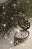 Christmas time. Vintage pocket watch and falling snow Stock Images