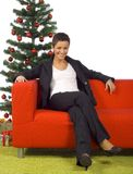 Christmas time - woman on the sofa Royalty Free Stock Photo
