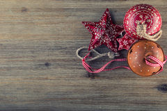 Christmas time. Wrought metal plate filled with various Christmas decorations. Christmas stars, Jingle bells in various positions. Royalty Free Stock Photo