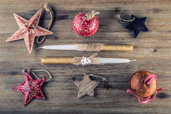 Christmas time. Wrought metal plate filled with various Christmas decorations. Christmas stars, Jingle bells in various positions. Stock Photography