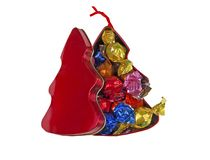 Christmas tin box filled with chocolate candies royalty free stock photos
