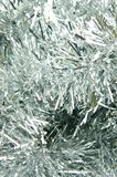 Christmas Tinsel. Silver decretive christmas tinsel isolated Royalty Free Stock Image