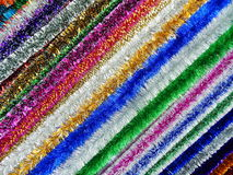 Christmas tinsel as a background. The shot was made at the International Specialized Trade Fairs GIFTS EXPO. AUTUMN 2014 Royalty Free Stock Photography