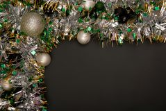 Christmas tinsel is on black background. Christmas tinsel is on black background, New-year decorations Royalty Free Stock Photo