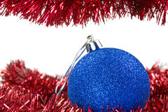 Christmas tinsel and blue bauble Royalty Free Stock Photo