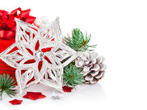 Christmas tinsel with branch firtree and red gift Stock Photo