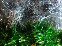 Christmas tinsel decoration for a festive background or New Year. White yellow green and pink royalty free stock photos