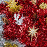 Christmas Tinsel and Decorations. Christmas Tinsel, Stars and Reindeer in red, gold and silver stock photography