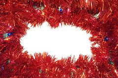 Christmas Tinsel Garland With Lights On White Background royalty free stock images