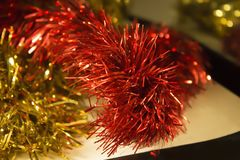 Christmas tinsel red and gold close up royalty free stock photo