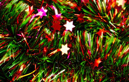 Christmas tinsel with stars Royalty Free Stock Image