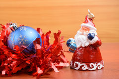 Christmas tinsel and toys on a wooden background Stock Photo