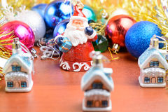 Christmas tinsel and toys on a wooden background Royalty Free Stock Image