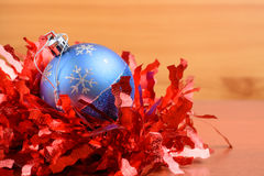 Christmas tinsel and toys on a wooden background Stock Image