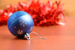 Christmas tinsel and toys on a wooden background Stock Images