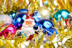 Christmas tinsel and toys on a wooden background Royalty Free Stock Photo