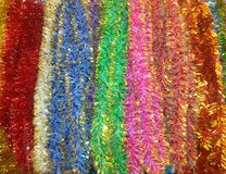 Christmas tinsel on the tree royalty free stock photo