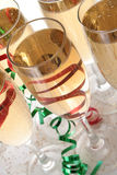 Christmas toast toast. Wine glasses with ribbons and confetti Royalty Free Stock Photo