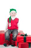 Christmas toddler with presents Stock Image