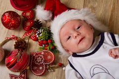 Christmas toddler in Santa hat Royalty Free Stock Image