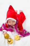 Christmas toddler in Santa hat Royalty Free Stock Images