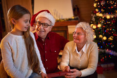 Christmas - together family giving their gifts Stock Images
