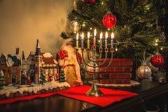 Christmas tolerance. Christmas Tree and the Jewish menorah stock photos