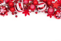 Red Christmas ornament top border isolated on white stock photo