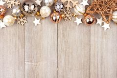White and gold Christmas ornament top border on wood. Christmas top border with white and gold ornaments on a rustic wood background Stock Images