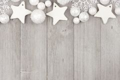 Christmas top border with white ornaments on gray wood Royalty Free Stock Images