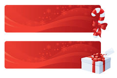 Christmas Toppers. Swirly red festive web banners with red and white gift and candy cane Royalty Free Stock Images
