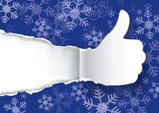 Christmas torn paper with Thumbs up. Royalty Free Stock Photos