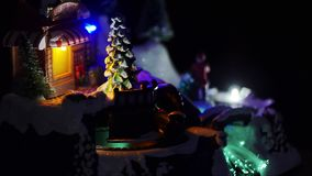 Christmas town and Christmas lights. Train in the night, Christmas tree, black background stock footage