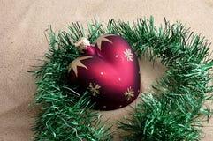 Christmas toy. Christmas toy on sand Stock Photo
