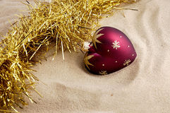 Christmas toy. Christmas toy on sand Royalty Free Stock Images