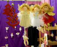 Christmas toy angels. With red trees, the lyre and the star Stock Photos