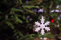 Christmas toy as a snowflake. Hanging on a Christmas tree stock image