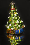 Christmas toy. As Christmas tree on black background Royalty Free Stock Image