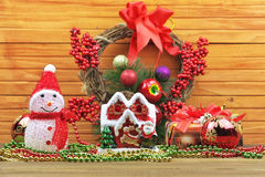 Christmas toy balls with snowman, berries, gifts, beads, toy hom Stock Photography