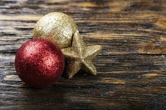 Christmas toy balls on a wooden background. Place for text royalty free stock images