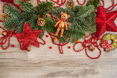 Christmas toy bear and fur-tree branch Stock Images