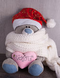 Christmas toy bear with santa hat on wooden background Royalty Free Stock Photo