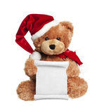 Christmas toy bear with wish list. Letter to Santa on white background royalty free stock photography